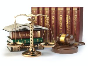 Gold scales of justice, gavel and books with differents field of