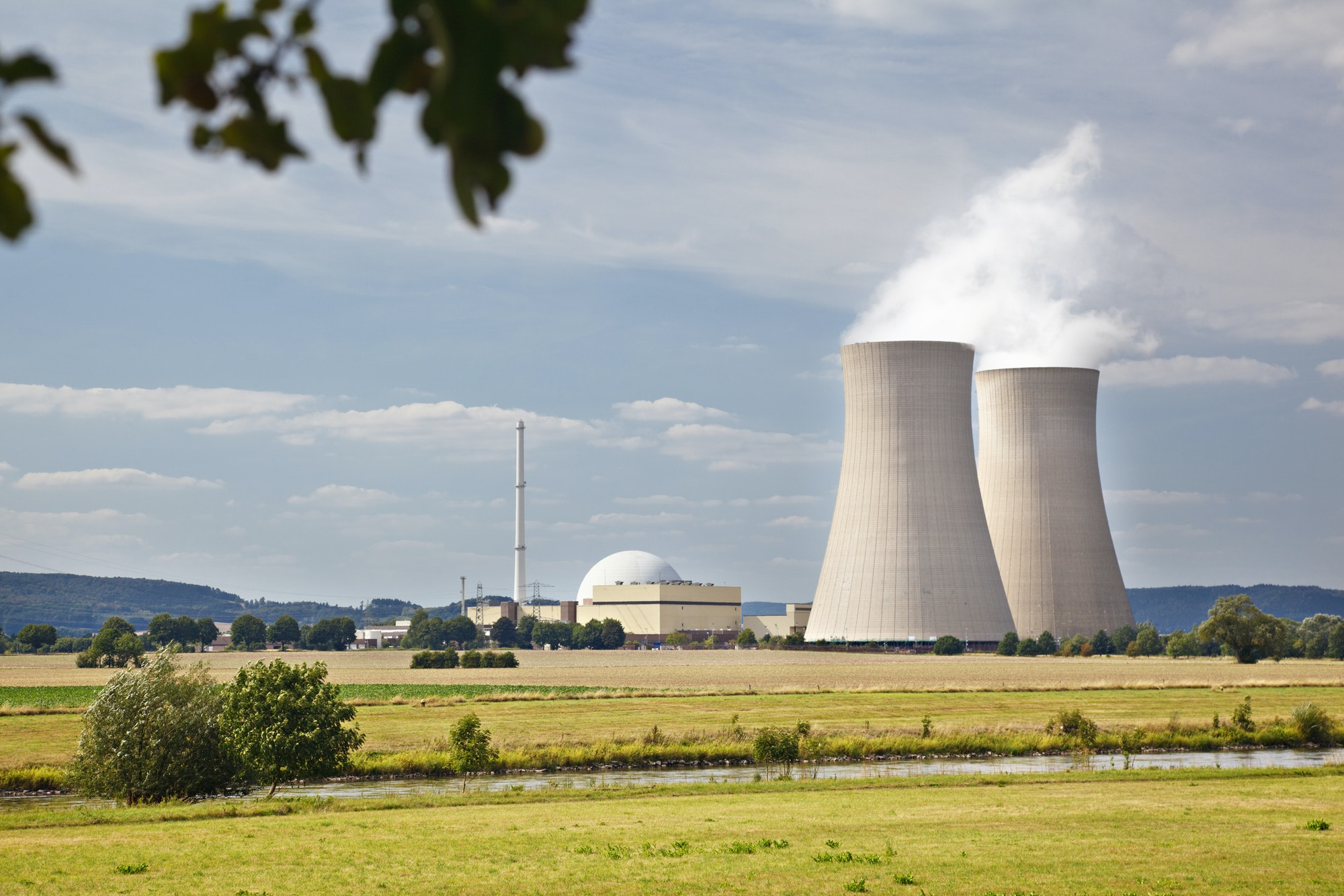 Nuclear Power Plant In River Landscape